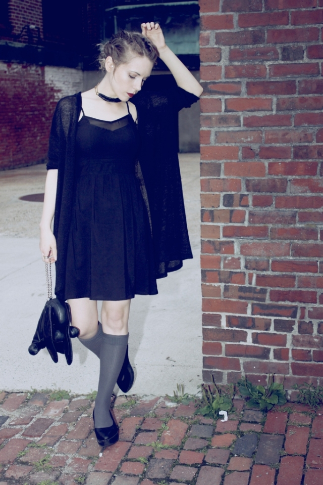schoolgirl goth leaning against the wall